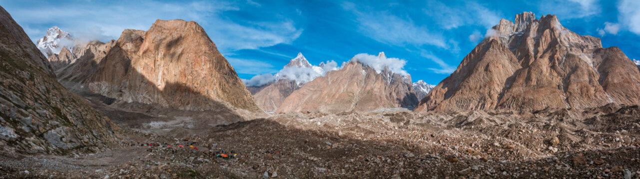 Panoramic view of Khoburtse Camp in morning from Baltoro Glacier with Liligo, Paiju, Uli Biaho, Great Trango Peak, Pakistan