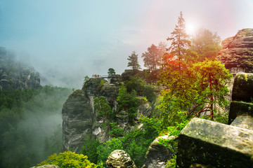 Bastei, Germany: Beautiful landscape with bastey rocks in the national Park Saxon Switzerland. Fog in the mountains