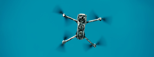 Flying drone in army camouflage skin. Banner. Wall mural