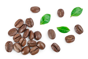 Poster de jardin Café en grains Heap of roasted coffee beans with leaves isolated on white background . Top view. Flat lay.