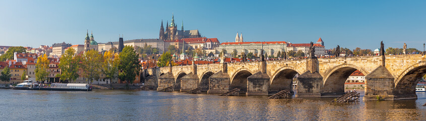 Poster Bruggen Prague - The panorama of Charles Bridge, Castle and Cathedral withe the Vltava river.