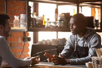 Male customer make order at black waiter near counter
