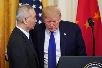 Chinese Vice Premier Liu He talks with U.S. President Donald Trump during U.S.-China trade signing ceremony at the White House in Washington