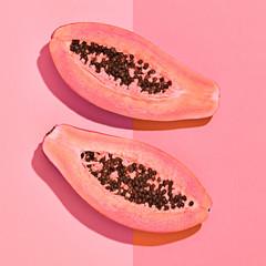 Fresh Papaya tropical Fruit. Bright pink Sweet Color. Flat lay. Trendy fashion Style. Minimal. Hot fashionable Summer vibes. Orange papaya fruit, Surreal. Detail, Pop Art
