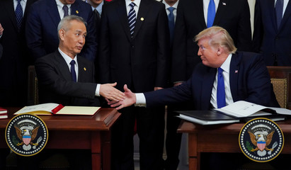 """Chinese Vice Premier Liu He and U.S. President Donald Trump shake hands after signing """"phase one"""" of the U.S.-China trade agreement at the White House in Washington"""