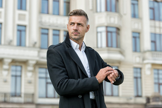 Whats the time. Businessman check watch outdoors. Handsome businessman hurry to business meeting. Elegant businessman in formal style. Businessman with smart and professional look. Business life