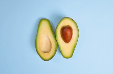sliced juicy avocado on a bright background