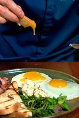 man eats eggs in a restaurant