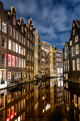 Poster Amsterdam Amsterdam canals and houses against night cityscape of Amsterdam, Holland Netherlands