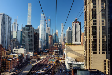 Ed Koch Queensboro Bridge from Manhattan to Queens and famous Roosevelt Island cable tramway. Shot makes from cabin of RIT. Transport of New York.