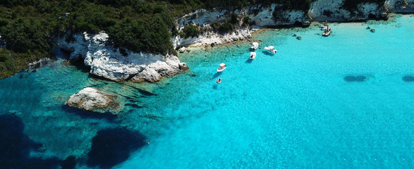 Türaufkleber Turkis Aerial drone ultra wide photo of paradise tropical exotic white rocky deep turquoise seascape forming a blue lagoon in Caribbean popular destination