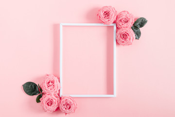 Poster Roses Beautiful flowers composition. Blank frame for text, pink rose flowers on pastel pink background. Valentines Day, Easter, Birthday, Happy Women's Day, Mother's day. Flat lay, top view, copy space