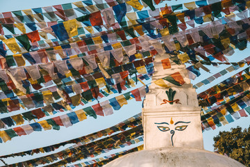 Angled view of colorful festival flags near statue