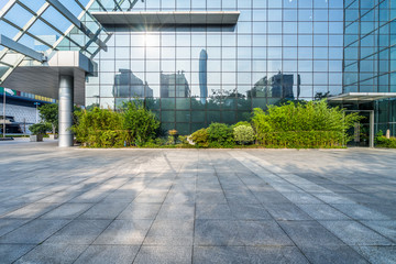 Fotomurales - modern buildings and empty pavement in china.