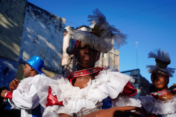 Dancers perform as Cuban and New Orleans musicians parade in downtown Havana