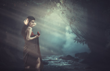 Asian woman was bathing in the brook in the creek, country girl portrait in outdoors, Thailand