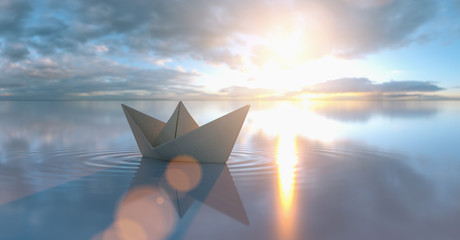 Deurstickers Zen Paper boat in a calm sea at sunrise sunset with cloudy sky