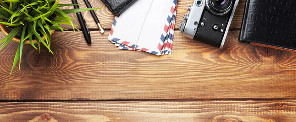 Camera and supplies on office wooden desk Wall mural