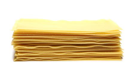 Uncooked Italian lasagna, pasta isolated on white background