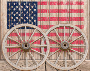 American flag, wheel on wood background
