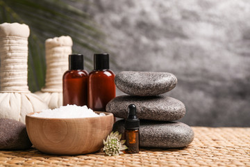 Beautiful spa composition with bath salt on wicker mat Fotomurales