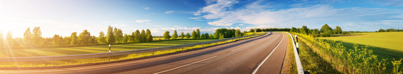 asphalt road panorama in countryside on sunny summer day Fotomurales