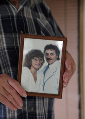Waldemar Hackstaetter shows a wedding picture of him and his wife Hildegard in their house in the village of Sirakovo