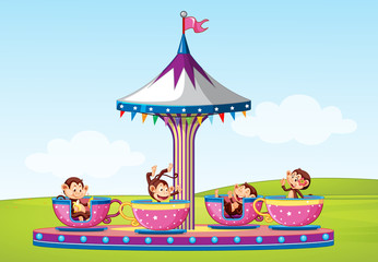 Foto op Canvas Kids Scene with monkeys riding in big cup in the park