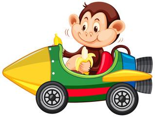 Foto op Aluminium Kids Monkey riding on toy rocket cart eating banana