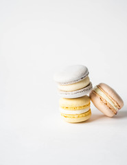 Keuken foto achterwand Macarons Stack of three fresh french pastel colorful macarons on white background. Copy space