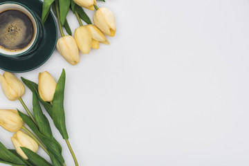 top view of tulips and fresh coffee isolated on white with copy space
