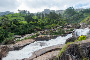 Atukkad Waterfalls near Munnar in Kerala, South India on cloudy day in rain season