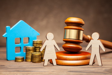 Divorce by law. Division of property after a divorce. The husband is trying to sue his wife for property under the law. A woman with a house and money, and a man with a hammer of a judge