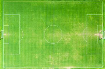 top view of green grass football stadium or field.