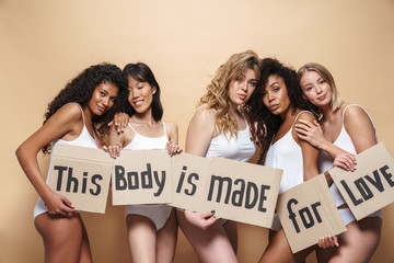 Image of seductive multinational women posing with placards