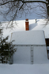 snow-covered roof of the cottage in the mountains