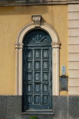 vintage wooden door in yellow wall