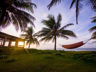 Hammock on a beach at sunset