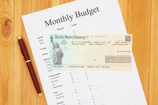 Living on Social Security a payment check with a monthly budget