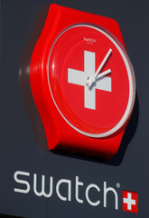 Logo of Swiss watch manufacturer Swatch is seen at a shop on Buergenstock