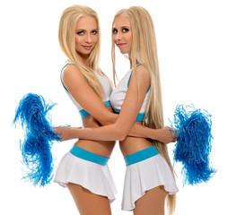 Studio photo of sexy cheerleaders hugging