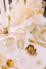 Foto auf Gartenposter Alkohol tableware beige background cutlery candlestick restaurant luxury