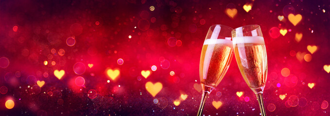 Valentines Celebration - Toast With Champagne With Defocused Lights In Red Shiny Background