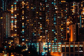 city lights of skyscraper buildings at night, downtown cityscape of hongkong at night
