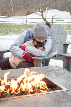 woman and her dog relaxing outdoor at a fireplace in Vermont