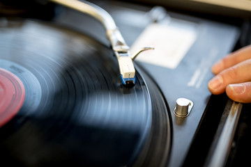 closeup of a record player and hand
