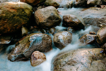 Long exposure of creek running in the California mountains