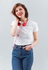 Lovely woman with red earphones