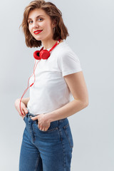 Lovely woman with red earphones in casual clothes