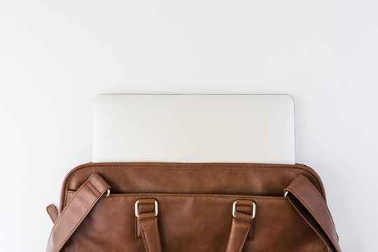 Brown business leather briefcase with notebook isolated background